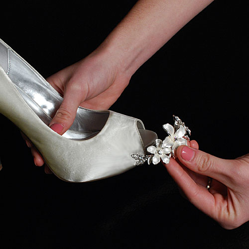 DIY Wedding Shoes. Finding a pair of heels in a particular color can be a pain. Skip afternoons running from store to store and select the color you love from Paris XOX instead. There are TONS of custom colors available. The image above showcases a pair of their blue heels for inspiration. Here's another pair we love with custom embellishment.